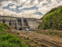 View of the of a dam and a hydroelectric power station. With a dramatic sky Stock Photography