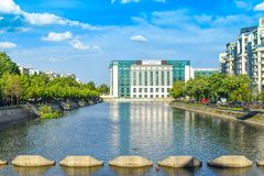 View of Dambovita river and National Library in a sunny spring day - Bucharest, Romania - 20.05.2019 royalty free stock photography