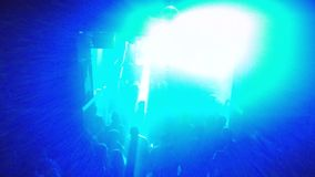 View of the dance floor of an underground techno club with blink rays of light. View of the dance floor of an underground techno club with blink rays of blue stock footage