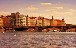 View of the Dancing house and embankment of the Vltava river. Royalty Free Stock Image