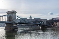 View from the Danube Embankment to the Chain Ssecheny Bridge and the Royal Palace in Budapest, Hungary stock photo