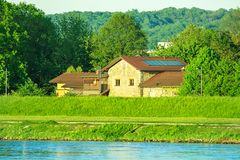 View of Danube River Bank of Donaupark in Linz Upper Austria. Vi. Brant Green Color Golden Sunlight Mountain Panorama in the Background. Summertime Spring Royalty Free Stock Photos