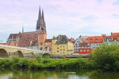 View of of Danube river bank and St. Peter`s Cathedral in Regensburg, Germany. stock photography