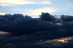 A view of the dark clouds during sunset stock photography