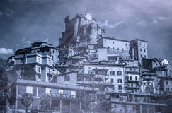 View of dark mountain village with castle, Subiaco. Lazio Royalty Free Stock Images