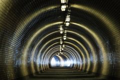 View Through a Dark Tunnel With the Light at The End Royalty Free Stock Images