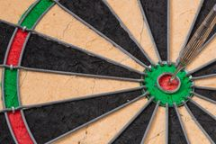 A View of a Dartboard with a dart in the Bullseye. royalty free stock photos