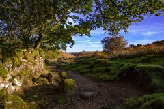View of Dartmoor from the path to Wistmans Wood. A view of Dartmoor from the path towards Wistmans Wood on a sunny September day with blue sky and clouds royalty free stock photography