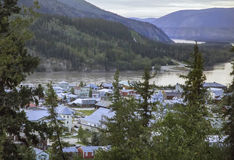 Looking Down on Dawson City. This is a view of Dawson City, Yukon, Canada, headed down from the Midnight Dome, a mountain top about 1,300 feet over the city Royalty Free Stock Images