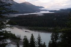 A view at daybreak of the Athabasca River as it weaves its way through the Jasper National Park, Canada, on a cloudy day. A view at daybreak  of jasper and the stock images