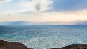View Dead Sea from Jordan shore in winter evening Stock Photography