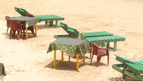 View of deck chairs and tables on beach in Weligama, Sri Lanka stock video