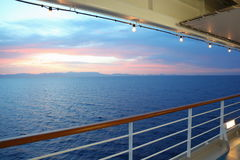 View from deck of cruise ship. sunset. Beautiful view from deck of cruise ship. sunset. row of lamps Royalty Free Stock Image