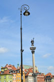View of the decorative street lamp and column of the king Sigismund III. Warsaw, Poland stock photo