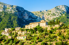 View of Deia on Mallorca. A view of Deià, a small coastal village in the Serra de Tramuntana, which forms the northern ridge of the Spanish island of Mallorca Stock Photo