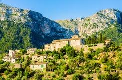 View of Deia on Mallorca. A view of Deià, a small coastal village in the Serra de Tramuntana, which forms the northern ridge of the Spanish island of Mallorca Stock Photo