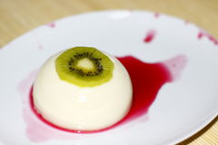 Delicious kiwi dessert penna cotta Stock Photo
