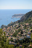 View of densely populated city. Monte Carlo, Monaco - September 20, 2015: view of densely populated city at bottom of mountain and sea port harbor yachts Stock Images
