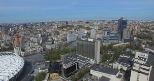 View of a densely populated city of urbanized life. Buildings and a horizon line on a sunny day Kiev. Traffic and streets of the metropolis and attractions and stock video