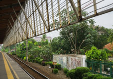 A view from Depok station forward to a green landscape with bog trees and bushes photo taken in Depok Indonesia Royalty Free Stock Photos