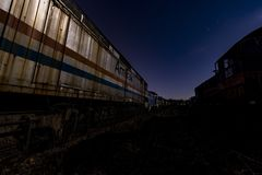 Amtrak Locomotive at Twilight - Abandoned Railroad Trains. A view of a derelict Amtrak locomotive at twilight at an abandoned train railroad yard in Ohio stock photography