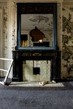 Derelict Fireplace - Abandoned Gundry Sanitarium - Baltimore, Maryland. A view of a derelict fireplace inside the abandoned Gundry Sanitarium in Baltimore stock photo