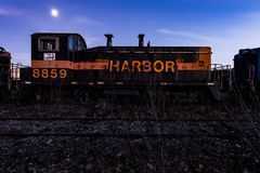 Derelict Indiana Harbor Locomotive at Twilight - Abandoned Railroad Trains. A view of a derelict Indiana Harbor locomotive at twilight at an abandoned train Stock Photography