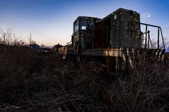 Derelict Locomotive at Sunset - Abandoned Railroad Trains. A view of a derelict locomotive at sunset at an abandoned train railroad yard in Ohio stock images