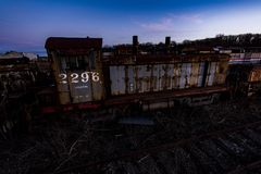 Derelict Locomotive at Twilight - Abandoned Railroad Trains. A view of a derelict locomotive at twilight at an abandoned train railroad yard in Ohio Royalty Free Stock Photo