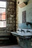 Derelict Restroom - Abandoned Old Crow Distillery - Kentucky. A view of a derelict restroom and sink at the long abandoned Old Crow Distillery near Frankfort stock photos