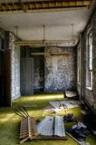 Derelict Room - Abandoned Knox County Infirmary - Ohio. A view of a derelict room with lime green carpet at the abandoned Knox County Infirmary near Mt. Vernon Stock Photography