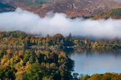 View of Derwent Water, Lake District in the morning and Autumn colours with cloud inversion royalty free stock images