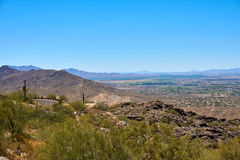 View of a desert landscape, with hills, cactus and a road. Phoenix, Arizona, USA stock photography