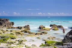 View of a deserted beach in Bermuda. A deserted beach in Bermuda with deep blue sea, rocks and crashing waves stock images