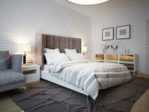 View of designed bed in contemporary bedroom Royalty Free Stock Photos