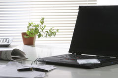 View of desk with laptop Royalty Free Stock Image
