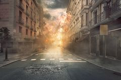 View of destruction city with fires and explosion. Over dramatic sky background royalty free stock photos