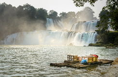 View at Detian waterfalls with bamboo raft on water Stock Photos