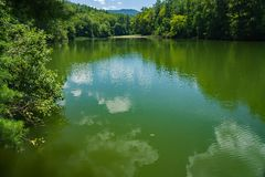View From Cave Mountain Lake Dam, Virginia, USA. View from Cave Mountain Lake dam located in the Jefferson National Forest, Rockbridge County, Virginia, USA Royalty Free Stock Images