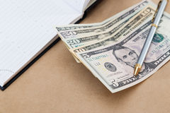View different bank notes, diary and pen stock photos
