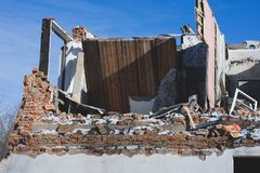 View of a dilapidated house. The destroyed walls in the process. Of demolishing the dilapidated house. Dismantling of old housing. Close-up Royalty Free Stock Images