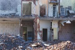 View of a dilapidated house. The destroyed walls in the process. Of demolishing the dilapidated house. Dismantling of old housing. Close-up Royalty Free Stock Image