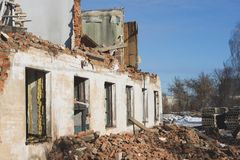 View of a dilapidated house. The destroyed walls in the process. Of demolishing the dilapidated house. Dismantling of old housing. Close-up Royalty Free Stock Photo