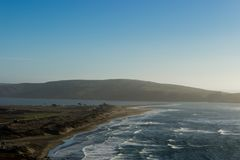 A view of Dillon Beach from on the hill at Oceana Marin. Blue sky and Tomales Bay and Point in the background. Pacific Ocean stock images