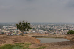 View of Dindigul city from the top of Rock Fort. Dindigul, India - October 23, 2013: Shot from the top of the Rock Fort. The city buildings in the distance royalty free stock image