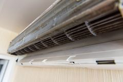 Air conditioning without front panel on wall royalty free stock image