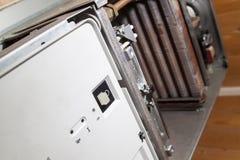View of the disassembled gas boiler for repair. Close up view of the disassembled gas boiler for repair royalty free stock photos