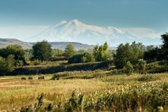 View of Mount Elbrus. View of the distant Mount Elbrus, distance directly to the mountain 150 km, Stavropol region royalty free stock photos