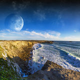 View of distant planet system from cliffs Royalty Free Stock Photography
