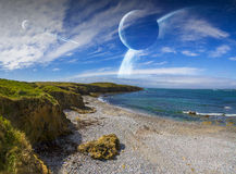 View of distant planet system from cliffs Royalty Free Stock Images